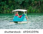 couple enjoying a leisurely... | Shutterstock . vector #693410596