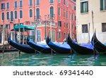 Gondolas in Venice at the pier - stock photo