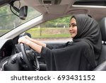 arab women driving car. | Shutterstock . vector #693431152