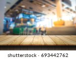empty wooden table and blur... | Shutterstock . vector #693442762
