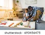 adorable african american... | Shutterstock . vector #693456475
