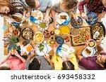 man in violet shirt eats... | Shutterstock . vector #693458332