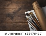 artistic tools on old dark... | Shutterstock . vector #693475432