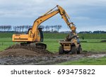 digger and a tip truck... | Shutterstock . vector #693475822
