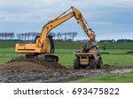 digger and a tip truck... | Shutterstock . vector #693475822