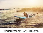 handsome man has surfing on... | Shutterstock . vector #693483598