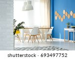 modern white wooden chairs in... | Shutterstock . vector #693497752