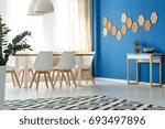 blue wall accent in minimalist... | Shutterstock . vector #693497896