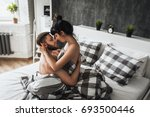 Stock photo guy and girl in bed 693500446