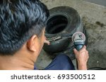 a man working with grinder | Shutterstock . vector #693500512