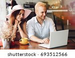 man and woman sitting in a...   Shutterstock . vector #693512566