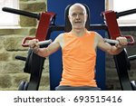 old man doing exercises in the... | Shutterstock . vector #693515416