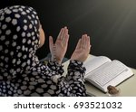 muslim girl hand prayer on... | Shutterstock . vector #693521032