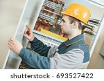 electrician with electric... | Shutterstock . vector #693527422