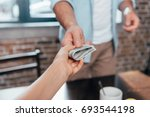 cropped shot of dad giving... | Shutterstock . vector #693544198