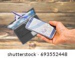 hand holding smartphone on... | Shutterstock . vector #693552448