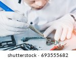 the technician repairing the... | Shutterstock . vector #693555682