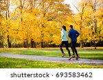 young couple jogging together... | Shutterstock . vector #693583462