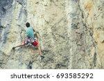 rock climber ascending a... | Shutterstock . vector #693585292