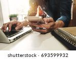 close up of hand using tablet ... | Shutterstock . vector #693599932