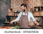 joyful young man with apron... | Shutterstock . vector #693605836