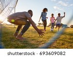 a boy kicks a football during a ... | Shutterstock . vector #693609082