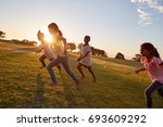 four children running barefoot... | Shutterstock . vector #693609292