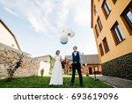 stylish happy bride and groom...   Shutterstock . vector #693619096