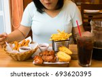 overweight woman eating junk... | Shutterstock . vector #693620395