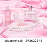 perfume bottles with rope of... | Shutterstock . vector #693622546