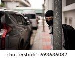 robber in black mask  robbery... | Shutterstock . vector #693636082