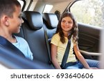 smiling siblings in the back of ... | Shutterstock . vector #693640606