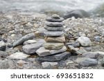 stone pyramid on the shore of a ... | Shutterstock . vector #693651832