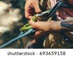 unrecognizable climber man... | Shutterstock . vector #693659158