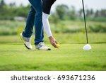 golfer put pin tee off before... | Shutterstock . vector #693671236