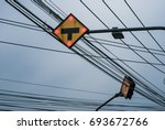 Small photo of T- junction traffic sign