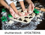 mother and daughter cooking at... | Shutterstock . vector #693678046