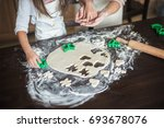 mother and daughter cooking at... | Shutterstock . vector #693678076
