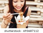 beautiful woman are eating... | Shutterstock . vector #693687112