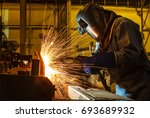 welder  welding automotive part ... | Shutterstock . vector #693689932