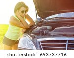 frustrated woman driver near a... | Shutterstock . vector #693737716