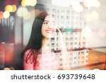 indian woman talking on phone... | Shutterstock . vector #693739648