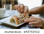hungarian chimney cake with... | Shutterstock . vector #693752512