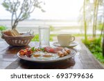 breakfast on the table in... | Shutterstock . vector #693799636