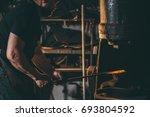 workshop of a blacksmith. a man ... | Shutterstock . vector #693804592