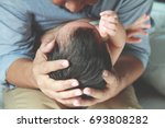 asian baby head on his father... | Shutterstock . vector #693808282