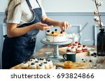 pastry chef in the kitchen... | Shutterstock . vector #693824866