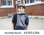 a nice pre teen boy outside at... | Shutterstock . vector #693851386