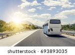 tourist bus rushes along the... | Shutterstock . vector #693893035