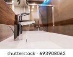 modern bathroom sink faucet... | Shutterstock . vector #693908062